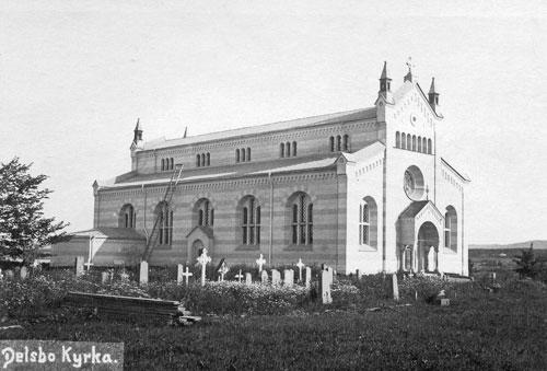 """Vykort """"Delsbo kyrka"""", (foto: Carl Rudolphi (Delsbo Hembygds- och Fornminnesförening, Sockenbilder Nr. NEO-143)."""